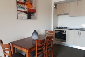 The dining area of the One Bedroom Hamilton Studio with Spa Bath.
