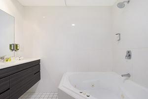 The Bathroom of a One Bedroom Apartment with Spa at the Boulevard Apartments.