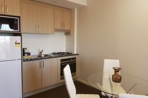 The Kitchenette and Dining Area of Hamilton 1 Bedroom Studio.