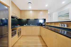 The Kitchen of the York 2 Bedroom Apartment on Newcastle Beach.