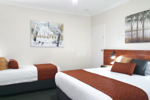 The King and Single Beds within one of the Triple Rooms.