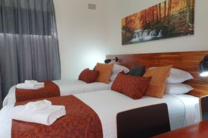 The King Rooms can be configured with twin share single beds.