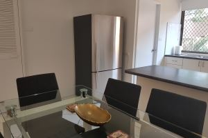 The Kitchen and Dining Area of the King 2 Bedroom Terrace Apartment at Centennial Terrace Apartments.