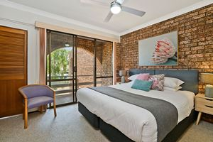 The Main Bedroom of Centennial Terrace Apartments Standard 2 Bedroom Unit.