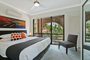 The Main Bedroom of Centennial Terrace Apartments Superior 2 Bedroom Unit.