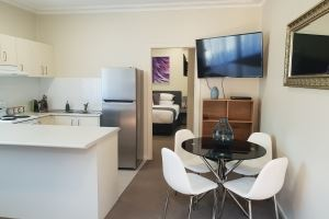 The Kitchen and Dining Area of Mayfield Short Stay Apartments.