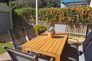 The rear deck of our Cooks Hill Cottage provides an outdoor dining setting, additional seating and BBQ.