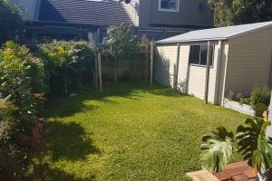 The rear yard of our Cooks Hill Cottage provides a lovely lawned area for your family to enjoy.