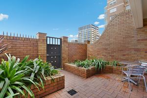 Sandbar Apartment provides a private outdoor courtyard with direct access to Newcastle Beach.